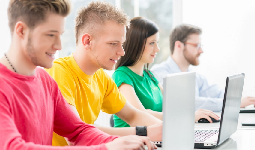 School leavers train as web developer apprentices in programming lesson